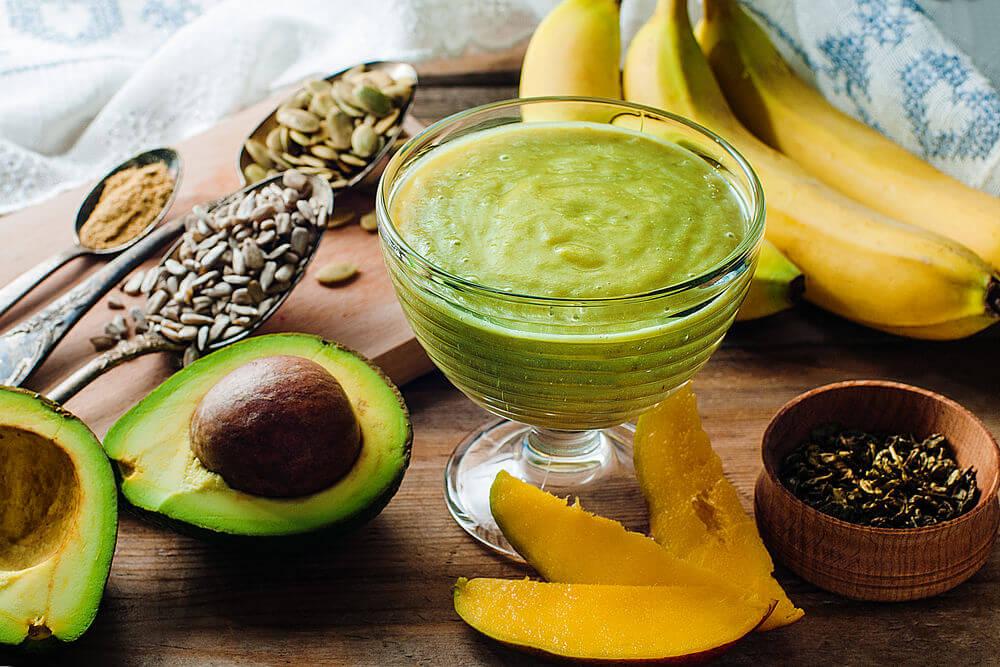 Banana, mango, sunflower seeds, ginger, avocado, green tea and pumpkin seeds smoothie