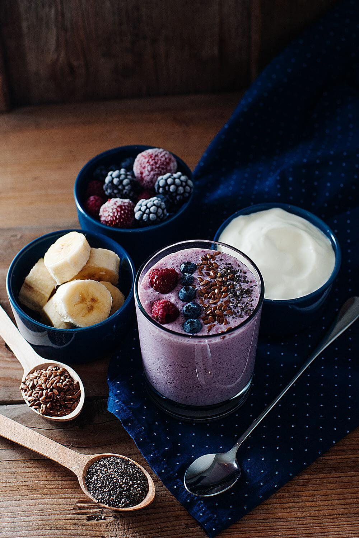 Banana, chia seeds, blueberries, strawberries, Greek yogurt, flax seeds, raspberries, coconut water and blackberries smoothie