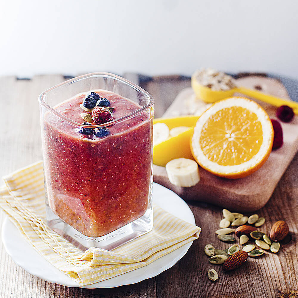 Banana, oats, almond milk, orange juice, strawberries, raspberries, mango, pumpkin seeds, almonds and blueberries smoothie