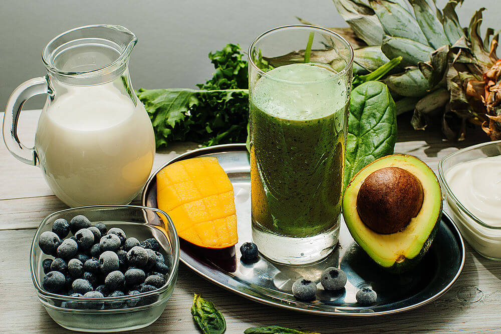 Blueberries, kale, avocado, mango, almond milk, Greek yogurt, pineapple and spinach smoothie