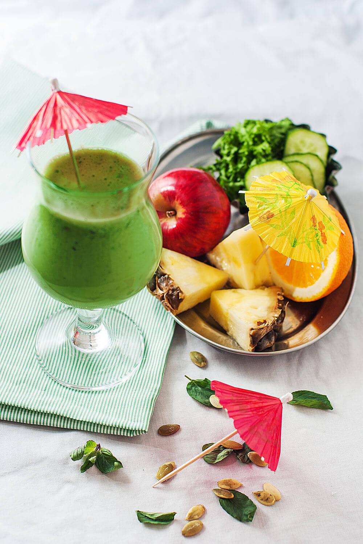 Cucumber, pineapple, red apple, almond milk, kale, pumpkin seeds, mint and orange smoothie