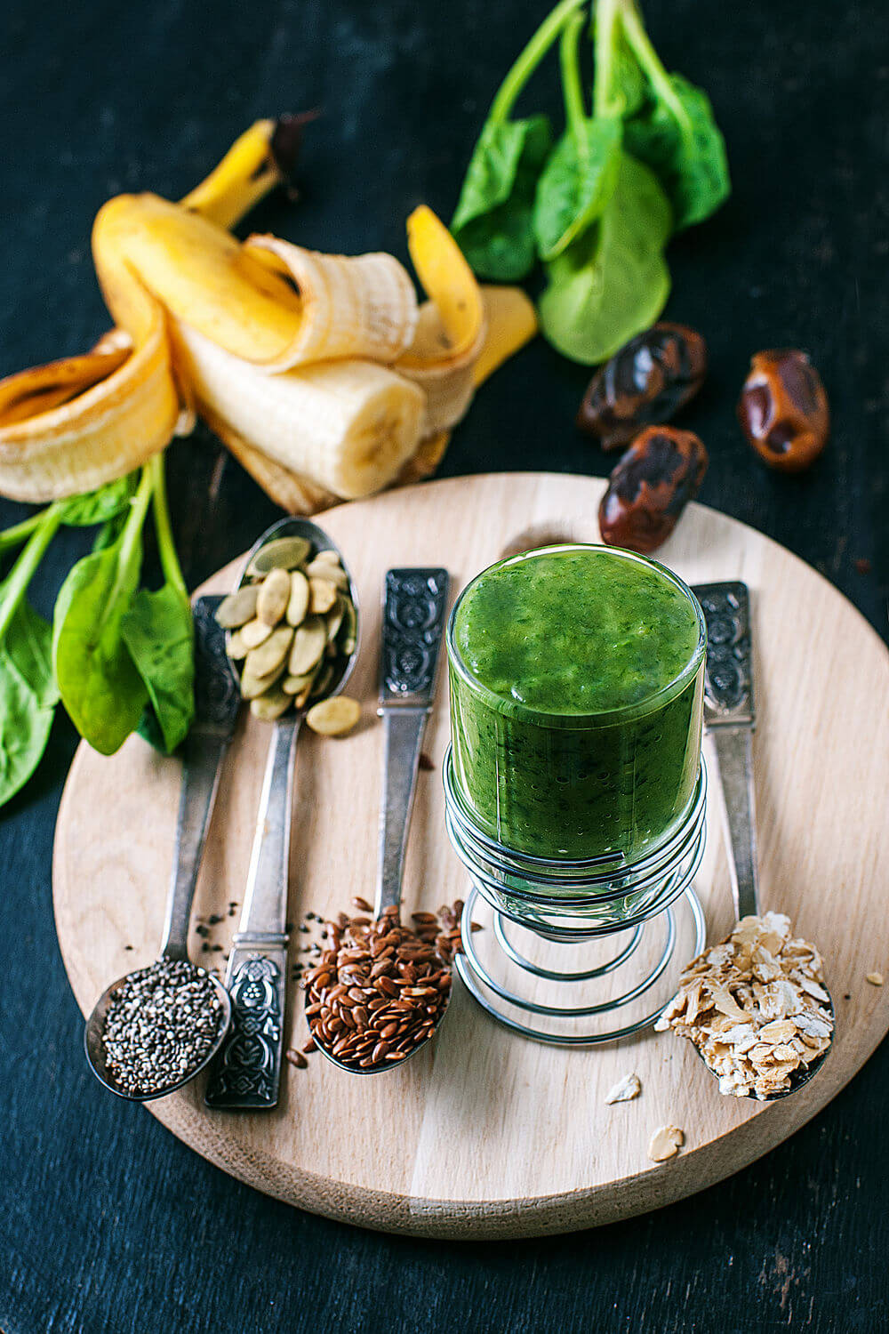 Flax seeds, spinach, oats, pumpkin seeds, coconut water, banana, swiss chard, medjool dates and chia seeds smoothie