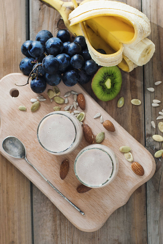 Banana, grapes, sunflower seeds, almonds, kiwifruit, pumpkin seeds and almond milk smoothie