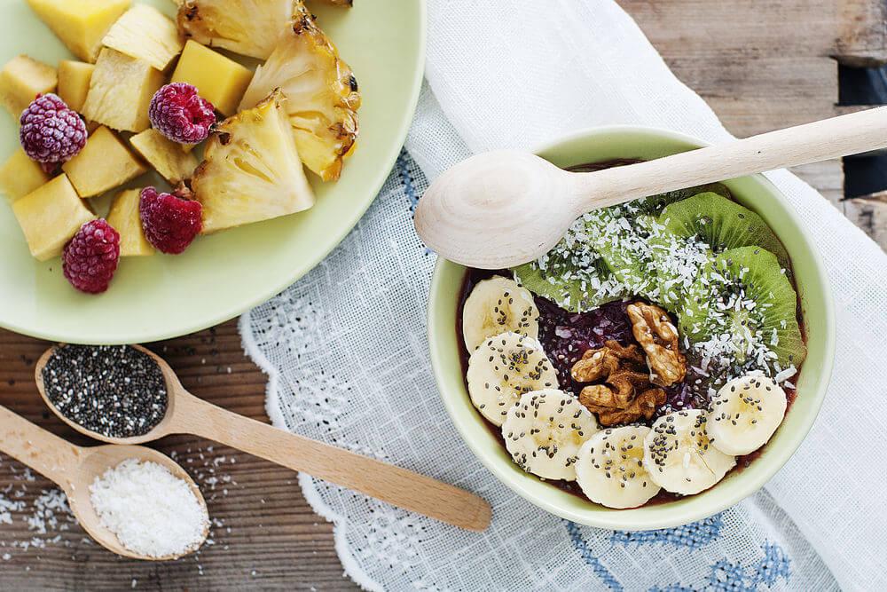 Raspberries, walnuts, pineapple, kiwifruit, coconut water, coconut (shredded), mango, banana and chia seeds smoothie