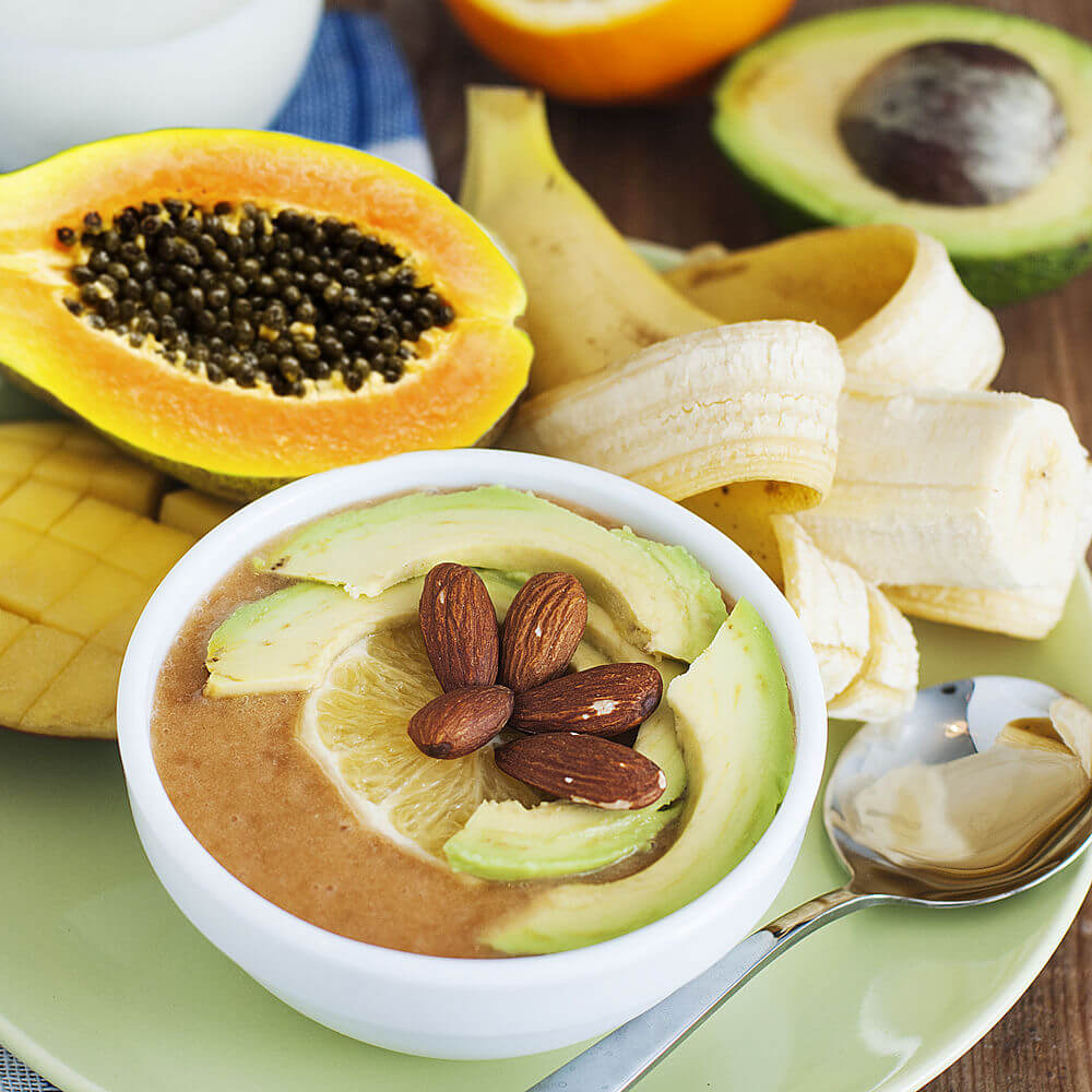 Papaya, Greek yogurt, milk, mango, avocado, banana, almonds, almond butter and orange smoothie