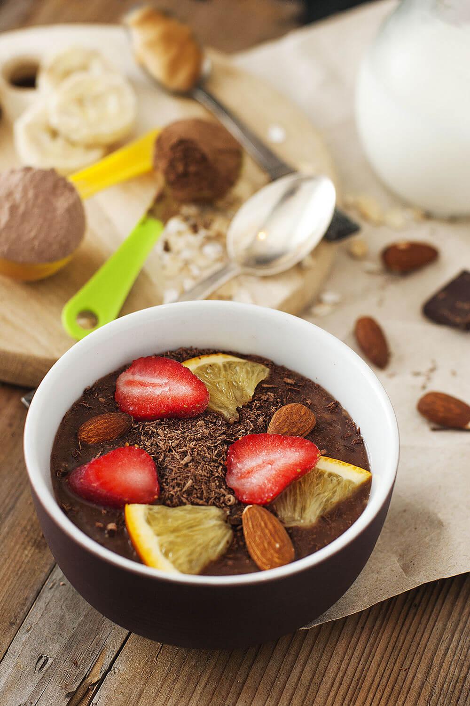 Peanut butter, oats, almonds, banana, whey protein powder, almond milk, orange, cocoa powder, dark chocolate and strawberries smoothie