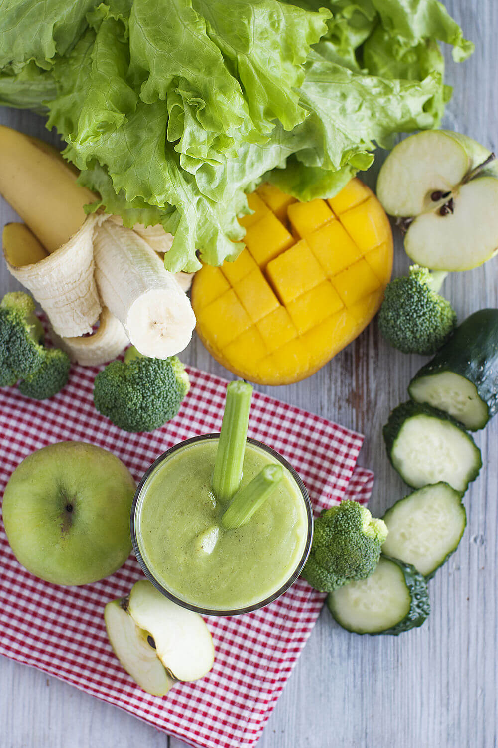 Cucumber, water, lettuce, banana, mango, celery, broccoli and green apple smoothie