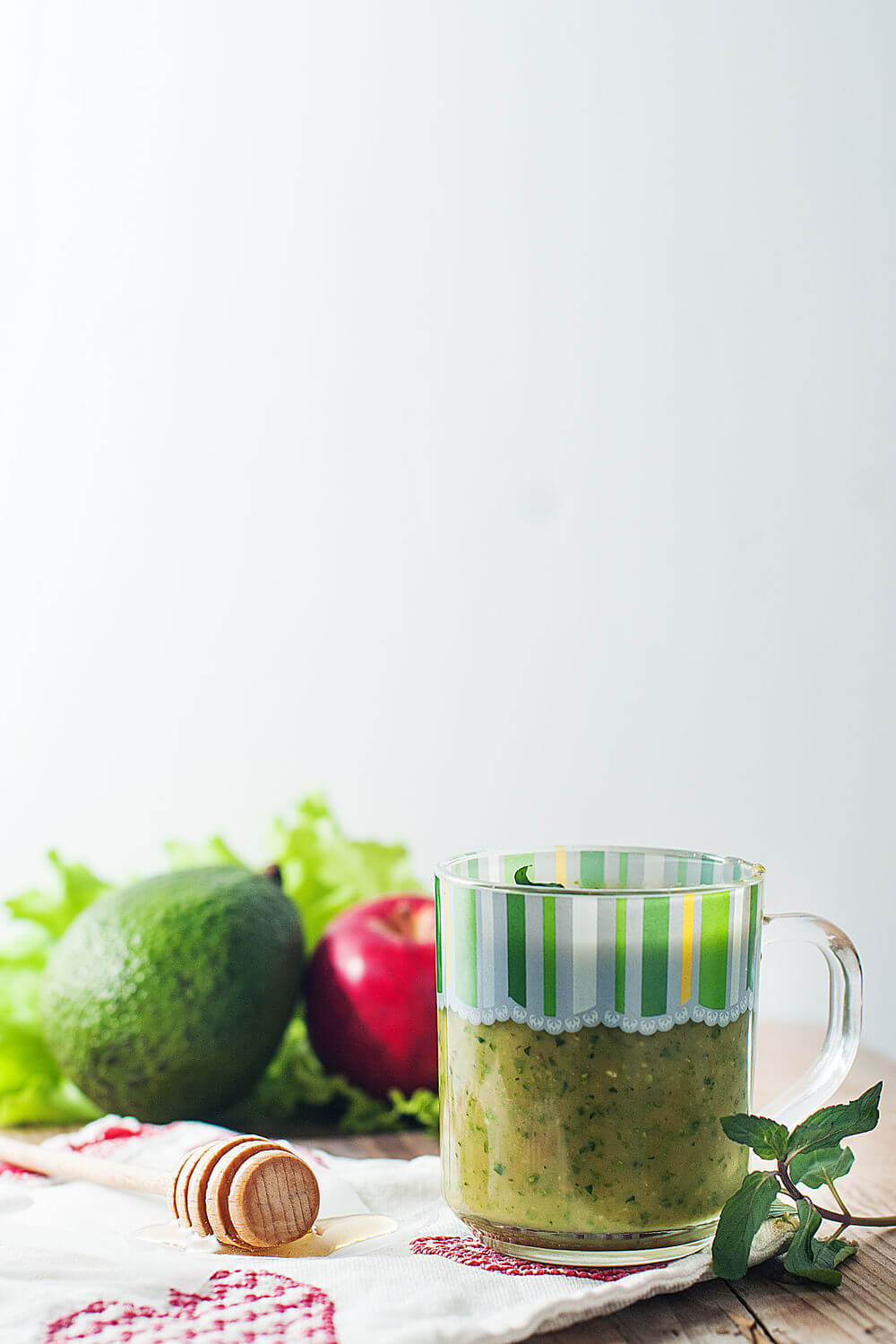 Avocado, red apple, coconut water, honey, mint and romaine lettuce smoothie