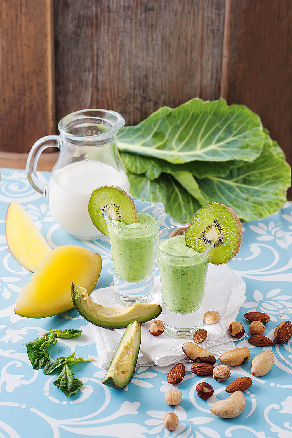Spinach, hazelnuts, Brazil nuts, pumpkin seeds, almonds, avocado, mango, collard greens, almond milk and kiwifruit smoothie