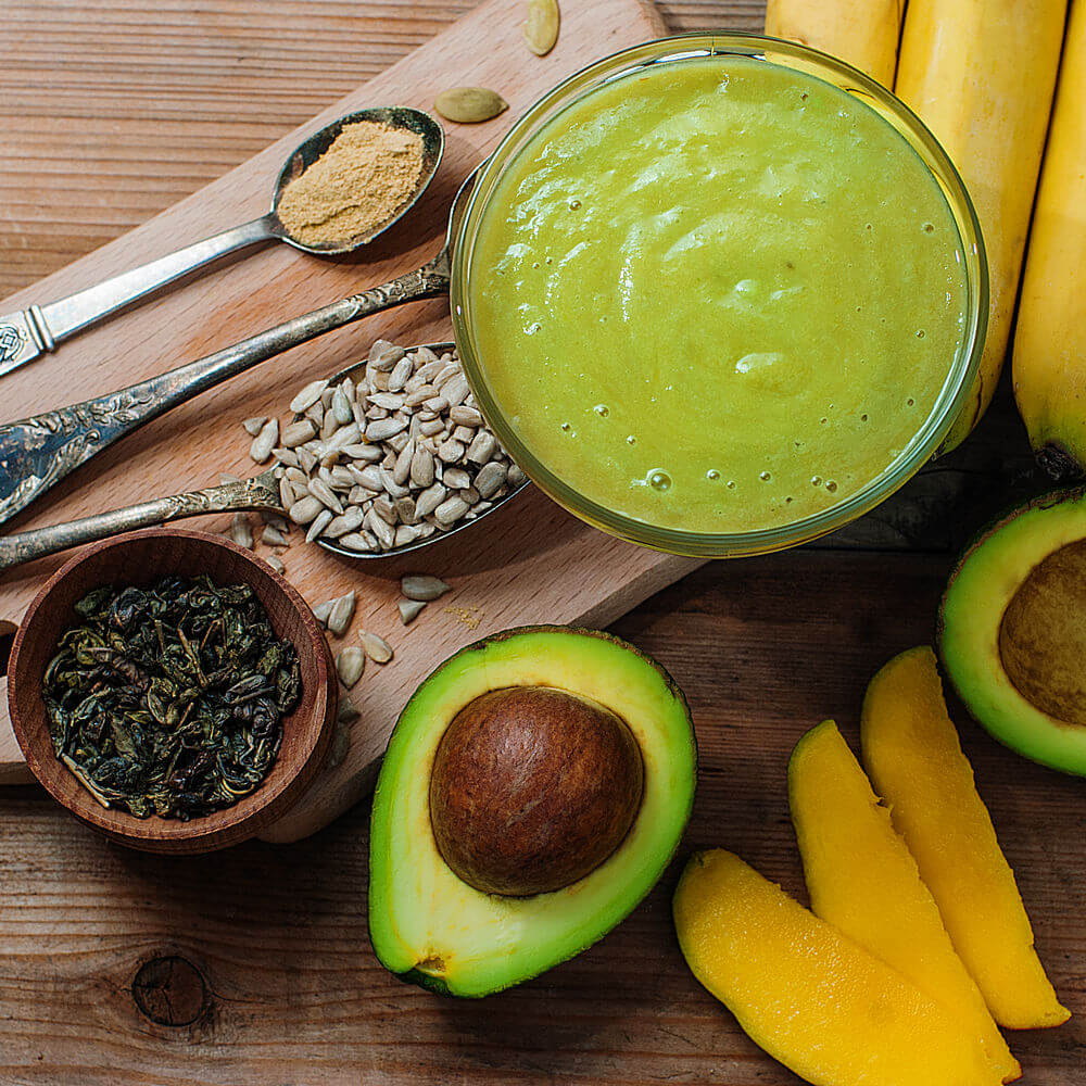 Banana, mango, sunflower seeds, ginger, avocado, green tea and pumpkin seeds smoothie