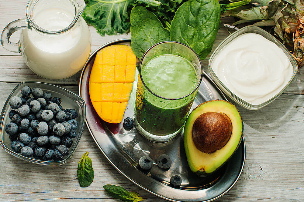 Blueberries, kale, avocado, mango, almond milk, Greek yogurt, pineapple and spinach smoothie