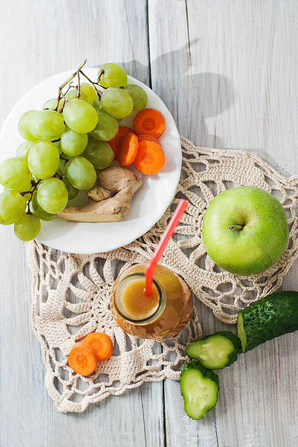 Green apple, water, carrot, grapes, cucumber and ginger smoothie