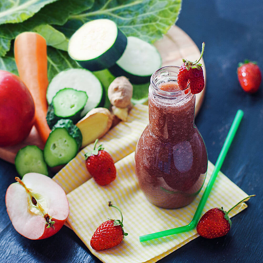 Collard greens, water, carrot, strawberries, ginger, zucchini, cucumber and red apple smoothie