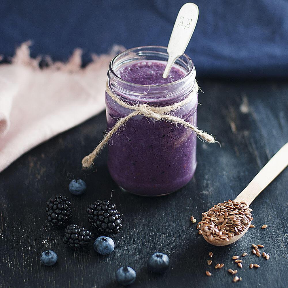 Banana, blackberries, almond milk, blueberries and flax seeds smoothie