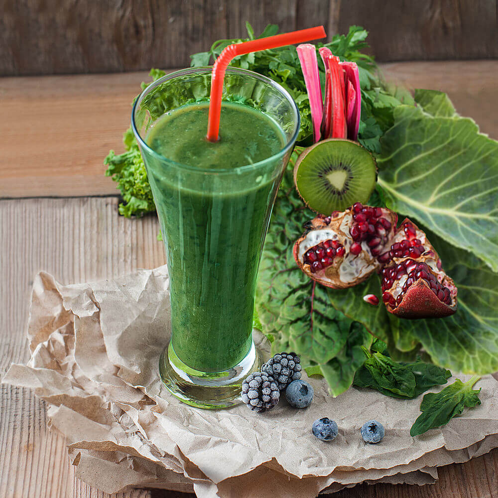 Spinach, kale, blackberries, swiss chard, parsley, kiwifruit, collard greens, pomegranate juice, blueberries and water smoothie