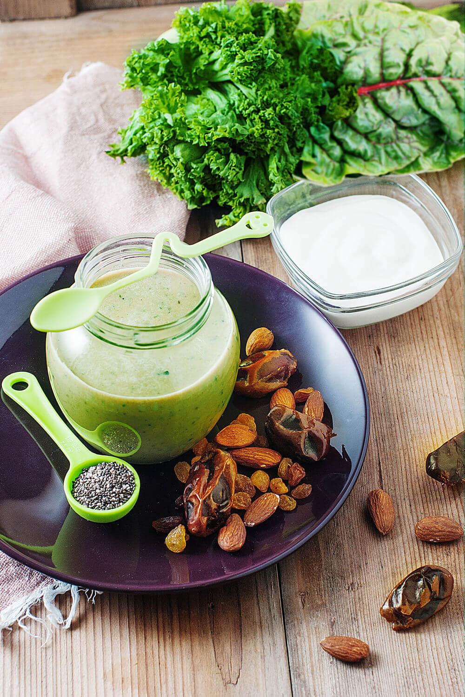 Kale, collard greens, almonds, Greek yogurt, raisins, chia seeds, medjool dates and milk smoothie