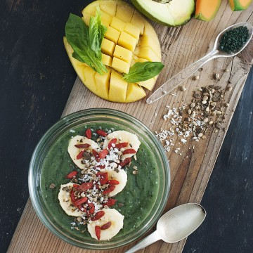 Emeralds in a bowl - Spirulina, banana, coconut (shredded), hemp seeds, mango, cantaloupe, watermelon juice, avocado, goji berries and spinach smoothie